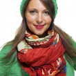 Woman in colorful scarf  posing at camera — Stock Photo #74338573