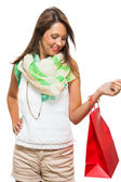 Joyful, attractive woman with shopping bag — Stock Photo