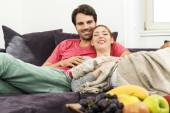 Young couple watching TV together — Stock Photo