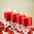 Red candles with christmas decorative beads — Stock Photo #76021611