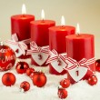 Red candles with christmas decorative beads — Stock Photo #76021429