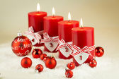 Red candles with christmas decorative beads — Stock Photo