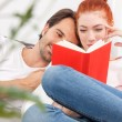 Young couple reading book together — Stock Photo #78521552