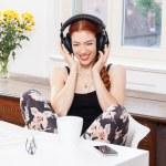 Woman with big earphones enjoying music — Stock Photo #78529402