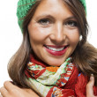 Woman in colorful scarf  posing at camera — Stock Photo #78536534
