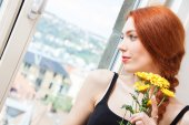 Red haired woman with yellow flowers — Stock Photo