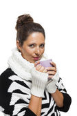 Attractive woman enjoying hot drink — Stock Photo