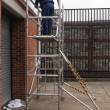 Working from a scaffold tower — Stock Photo #64647885