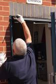 Painting a doorframe — Stock Photo