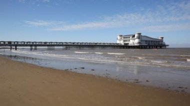 Grand Pier and beach Weston-super-Mare Somerset England UK on a beautiful summer day with blue sky in this popular West Country tourist resort — Stock Video