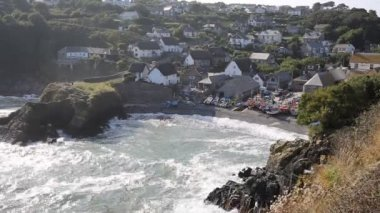 Cadgwith Cornwall fishing village on the Lizard Heritage coast South West England on a sunny summer day with waves — Stock Video