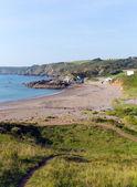 Coast path Kennack Sands beach Cornwall the Lizard South West England with blue sky on a sunny summer morning — Stock Photo