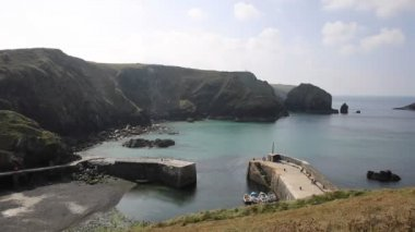 Mullion Cove harbour Lizard peninsula south Cornwall UK situated on Mounts Bay elevated view PAN — Stock Video
