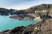 Tourists and visitors enjoying Kynance Cove The Lizard near Helston Cornwall England UK on a beautiful sunny summer day with blue sky and sea — Stock Photo