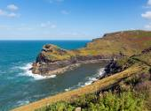 Boscastle coast and entrance to the harbour North Cornwall between Bude and Tintagel England UK on a beautiful sunny blue sky day — Stock Photo