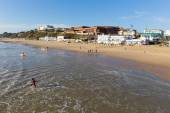 Surfers on Bournemouth beach Dorset England UK near to Poole known for beautiful sandy beaches — Stock Photo