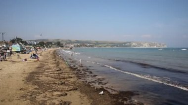 Swanage beach Dorset England UK with waves on the shore near Poole and Bournemouth at the eastern end of the Jurassic Coast a World Heritage Site popular south coast tourist destination — Stock Video