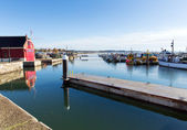 Poole harbour and quay Dorset England UK with boats on a beautiful calm day with blue sky — Foto de Stock