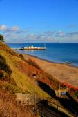 Bournemouth beach pier and coast Dorset England UK near to Poole known for beautiful sandy beaches with blue sky — Stock Photo