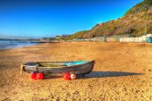 Rowing boat Bournemouth beach Dorset England UK like a painting in vivid bright colour HDR — Foto de Stock