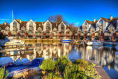 Christchurch Priory Quay Dorset England UK exclusive marina development  in bright vivid colourful HDR like painting — 图库照片