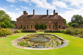 Strode House Barrington Court near Ilminster Somerset England uk with Lily pond garden — Stock Photo