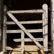 Very old wooden stable door hundreds of years old — Stock Photo #67640465