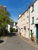 Hawkshead village street in the Lake District England uk on a beautiful sunny summer day popular tourist village — Stock Photo