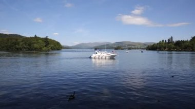 Beautiful peaceful relaxing summer day in the English Lake District Bowness Windermere England uk with a boat at this popular tourist location — Stock Video