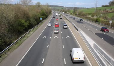UK motorway traffic with cars lorries and vehicles travelling on major roadway M5 Somerset on sunny day in spring to and from camera from bridge — Stock Video