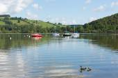 The Lake District popular beautiful UK holiday destination Ullswater Cumbria North England in summer with boats blue sky and cloud reflections — Stock Photo
