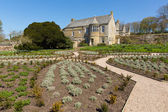 Trerice House Elizabethan manor near Newquay Cornwall uk a tourist attraction with beautiful gardens in spring with blue sky — Stock Photo