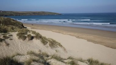 Crantock beach North Cornwall England UK near Newquay and on the South West Coast Path in spring with blue sky and sea PAN — Stock Video