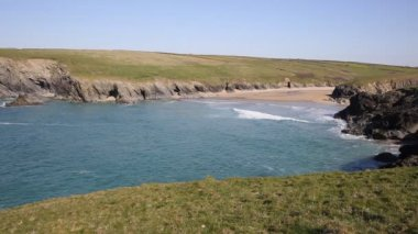 View to Porth Joke beach by Crantock bay Cornwall England UK near Newquay and on South West Coast Path also known as Polly Joke in spring with blue sea and sky — Stock Video