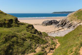 Pobbles beach The Gower Wales uk popular tourist destination and next to Three Cliffs Bay in summer with blue sky and sea — Zdjęcie stockowe