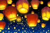 Floating lantern in night sky — Stock Vector
