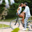 Kissing couple with bicycle — Stock Photo #54821811