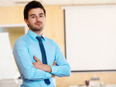 Businessman with arms folded — Stock Photo