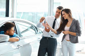 Car Salesman Giving a Key From the New Car — Stock Photo