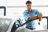 Man With Keys To The Car Of His Dreams. — Stock Photo