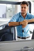Man in Car Showroom. — Stock Photo
