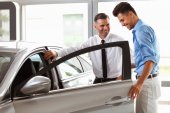 Vehicle Dealer Showing Young Man New Car — Stock Photo