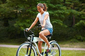 Woman is Cycling in Summer Park — Stock Photo