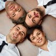 Business people team lying on the floor — Stock Photo #70384559