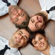 Business people team lying on the floor — Stock Photo #70384743