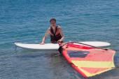 Mature adult windsurfing — Stock Photo