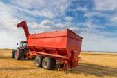 Agricultural tractor and harvesting trailer — Stock Photo