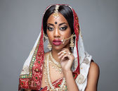 Exotic Indian bride dressed up for wedding — Stock Photo