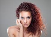 Beautiful woman with red curly hair — Stock Photo