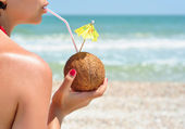 Girl with coconut cocktail — Stock Photo